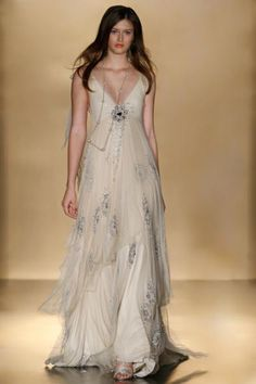 love the sheer overlay and the sweeping length