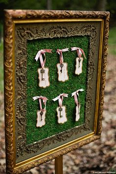 Creative seating chart with ribbon and vintage keys.