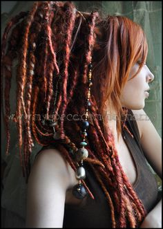 My new set: fluffy & thick wrapped dreads <3 I mixed a few shades of red: pumpkin, autumn mix, amber, velvet, honey moon from ikickshins.ne...