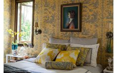 Lulu Powerssaw the guest room as an opportunity to have some fun. A traditional toile wallpaper by Pierre Deux reads more playful