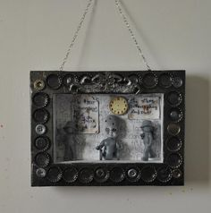 A bronze, silver and gold painted box frame assemblage. Silent Hill fans will recognise the reference to Grey Children. The frame is hand-made by me