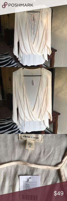 Silence +Noise long sleeve blouse urban Outfitters Silence + Noise from Urban Outfitters- cream colored, super low cut blouse with a higher front and a lower back. Can tie or untie, as shown in photos. Size small, never worn • make an offer on any item in my closet, prices are not set in stone ;-) silence + noise Tops Blouses