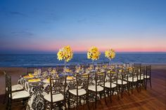 We're loving the pop of color from these yellow centerpieces in this wedding setup at Secrets Vallarta Bay. #UnlimitedRomance