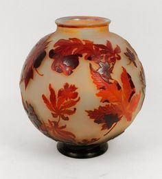 A vase depicting an Autumn Scene. The piece is very opalescent on the inside. Measures 11 3/4 inches in height, made in France, circa 1905