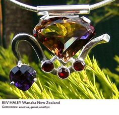 A soul necklace made for Bev Haley (Wanaka, NZ) - set with ametrine, garnet, and amethyst stones.