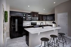 You can never go wrong with a classic black and white kitchen, like the Darby, at Bartram Creek- Classic Series in #jacksonville