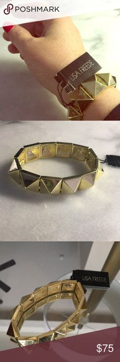 NWT Lisa Freede Spikes Gold tone Bracelet NEW New with tags,  gift ready bracelet by designer Lisa Freede.  Everyone loves these stretched bracelets to stack.Goth. Edgy or fun and preppy. Great for a gift. Gold tone. Comfortable. Lisa Freede is the designer to the stars. See pic of her with Katy Perry. Sold by active Posh Ambassador, 5 star love from my buyers. Lisa Freede Jewelry Bracelets