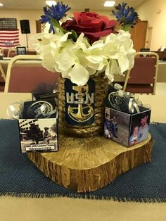 A possibility for our annual banquet but use yellow flowers instead and update the photos of the cadets from year to year. Military Retirement Parties, Military Party, Retirement Celebration, Retirement Gifts, Military Ball, Retirement Ideas, Navy Centerpieces, Graduation Table Centerpieces, Baseball Theme Birthday