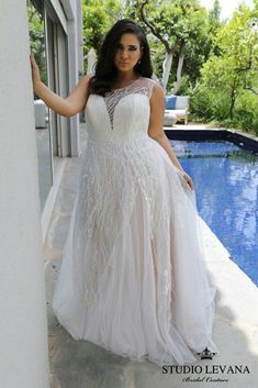 Plus size wedding gown with a stunning lace and a tulle skirt. One of a kind! #PlusSizeWeddingThings