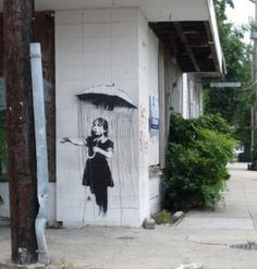 "New Orleans, after the storm by ""Banksy"", a British graffiti artist"