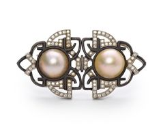 An art deco mabé pearl, diamond and blackened steel double-clip brooch, Marsh & Co, circa 1935  each centering a circular mabé pearl within a scrolling motif of blackened steel and accentuated with round brilliant-cut diamonds, delicately etched to reverse; unsigned; mounted in platinum; width: 2 1/4in.