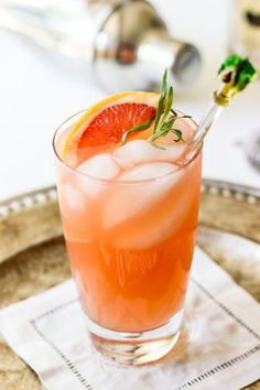 The Charleston Fizz. This refreshing cocktail is made with gin, Ruby Red grapefruit juice, Elderflower liqueur, simple syrup, a splash of club soda and some fresh tarragon. It's so refreshing, so delicious and so Charleston!