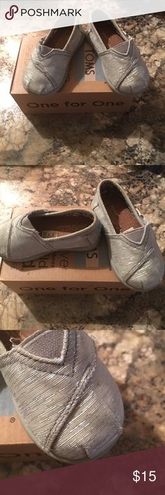 Toms infant shoes Shoes are infant size 4. Shoes are grey with a little sparkle. Only flaw a little dirty but not horrible you can see in pic 3 TOMS Shoes Slippers