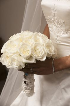 Creamy White Roses -- Timeless and Classic Wedding Bouquet. Nhan Photography   See more on SMP: http://www.StyleMePretty.com/southwest-weddings/2014/03/07/winter-wedding-at-the-crystal-ballroom/