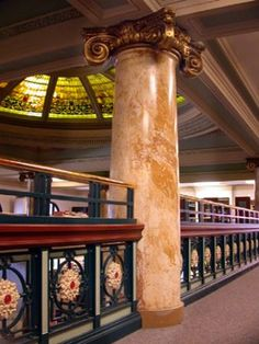 Looking up at the library dome from the balcony. Notice the beautiful marble pillar and the original ironwork railing.
