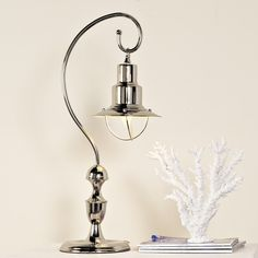 Nautical Lantern Table Lamp--They call it nautical--I call it modern and whimsical.  Find it at shadesoflight.com