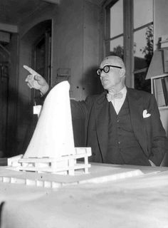 Architect Le Corbusier with the model of the Saint-Pierre Church at Firminy, France Modern Architects, Famous Architects, Sacred Architecture, Architecture Design, Bamboo Architecture, Creative Architecture, Bauhaus, Architecture Organique, Modernisme