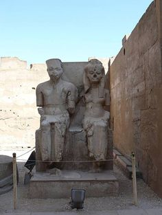 Statues of a young Tutankhamun and his consort Ankesenamun outside at Luxor Temple, Luxor, Egypt.