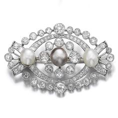 Natural pearl and diamond brooch, 1920s. The brooch millegrain-set with circular- and single-cut diamonds, accented with three natural pearls measuring from 7.38 x 7.60 x 8.07mm to 8.75 x 9.11 x 9.10mm, French assay mark