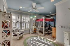Contemporary Kids Bedroom with Crown molding, Ceiling fan, Carpet, Built-in bookshelf