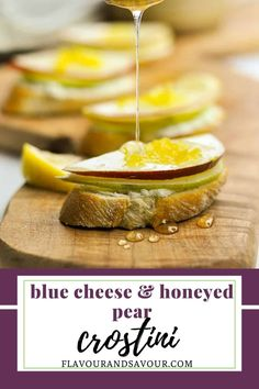 Make these popular Blue Cheese, Pear and Honey Crostini for your next party! Top thin slices of toasted baguette with whipped blue cheese, slices of crisp pear and a sprinkle of lemon zest. Drizzle with honey for the finishing touch to an amazing appetizer! #fingerfood #bluecheese #easy #quick