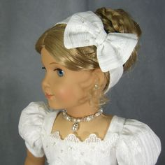 SIMPLY WHITE Regency set by idreamofjeannemarie on Ebay. This headband, which closes in back with velcro for a snug fit, has a lovely tailored bow embellished with more of the silver centered glass beads adding just the right amount of sparkle.