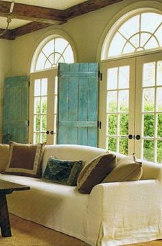 For a sunroom maybe. Love the color n shutter idea. Tall Windows+ Indoor Turquoise Shutters + Exposed Barn Wood Beams= one fabulous room!