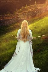 I am coming home II. (Moonless_Nigth_and_Melancholy) Tags: woman medieval fairy fantasy nature land gown dress bow arrow blonde longhair sun light grass outdoor dreamy conceptual