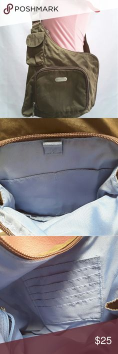 "Baggallini crossbody organizer Baggallini brown crossbody purse.?  Features include, front zipper pocket with two in slip pockets and pen holder, in is a wall zipper pocket and five credit card slots, rear slip pocket.?  Length 10.5"" height 9"" strap drop 24"" adjustable.?  This purse is in great condition and clean.?  Pets and smoking free home. Baggallini Bags Crossbody Bags"