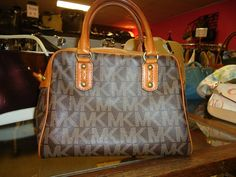 Michael Kors, Ms. Mulligan's Consignment Boutique