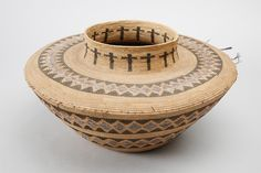 Central Californian jar-shaped basket, Tule River area, probably Yokuts, sedge root coiled on a grass bundle foundation, design in redbud and bracken fern root, early 1900s. Subjects: bottleneck baskets, diamond designs, crosses, rattlesnake designs