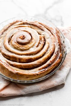 Learn how to make a GIANT cinnamon roll cake using an easy shortcut homemade cinnamon roll dough and swirling it into one large cake Top with vanilla icing for a fun and indulgent breakfast and brunch Recipe on Cinnamon Roll Dough, Cinnamon Rolls, Cinnamon Recipe, Cinnamon Cake, Baking Recipes, Cake Recipes, Dessert Recipes, Pavlova, Churros