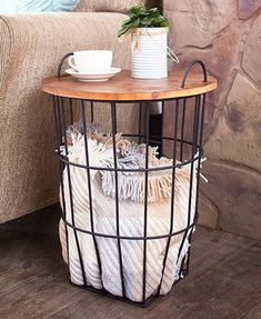 Add a sleek, modern touch to your home with this Wood Top Storage Basket Side Table. The dual-purpose piece offers a table for holding your beverage, snack, rem Storing Blankets, Side Table With Storage, Side Table Decor, Wooden Side Table, Diy Side Tables, Wire Side Table, Storage End Tables, Accent Table Decor, Accent Tables