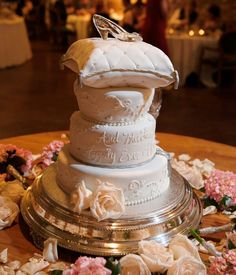 Cinderella wedding cake... I like the ring pillow with the glass slipper