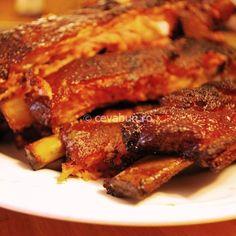 Coaste de porc la cuptor cu usturoi si rozmarin. Cum se fac coastele de porc in stil italian. Retete pentru preparat ribs. Porc cu usturoi si rozmarin.