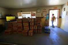 Cases of water collected by Donna Johnson, an East Porterville resident, who has led an effort to pr... - Jim Wilson/The New York Times