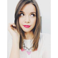 Sparkly necklace with a white top, colorful lips and straight hair