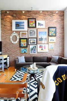 Love this gallery art wall on brick // Eloïse & Jose's Filled-with-Kijiji-Finds Montreal Loft — House Tour
