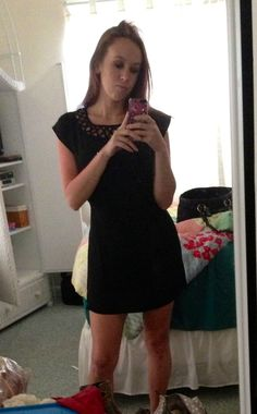 Simple black dress with cutout collar.