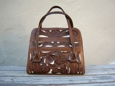 Tooled leather bag.