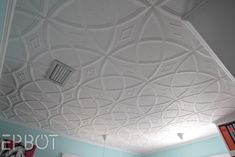 Styrofoam ceiling tiles - glues right over popcorn ceilings, and looks soooo coool.