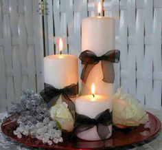With red candles, black ribbon, on a mirror