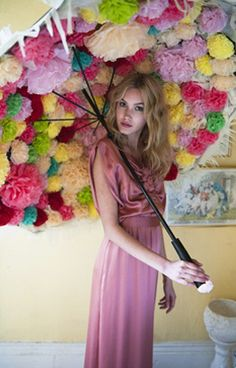 Pom Poms ... that's soo cute and I have a broken umbrella and now I know what to do with it :)