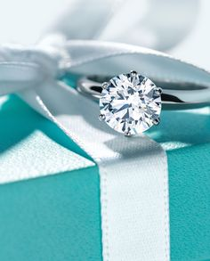 Tiffany & Co. is a longstanding and beloved institution in the diamond and jewelry world. Find out exactly what Tiffany & Co. can teach us about diamonds. Color Azul Tiffany, Verde Tiffany, Tiffany & Co., Diamond Rings, Diamond Engagement Rings, Tiffany Engagement, Wedding Engagement, Wedding Rings Vintage, Tiffany Jewelry