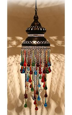 Love the jewel toned drops. Ottoman Chandelier