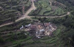 An aerial view of hillside residential buildings damaged by Saturday's earthquake at Trishuli Bazar in Nepal, on April 27, 2015.