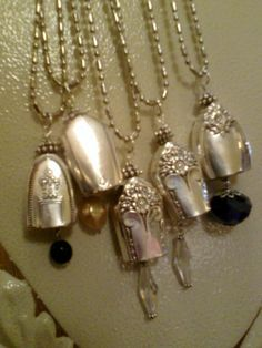 These vintage silverware necklaces with extra long chains are called Bell necklaces & are made from the end of knives.