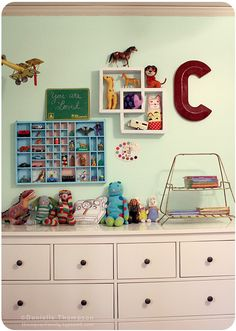 This gallery wall was made for teeny tiny collectibles. So cute!