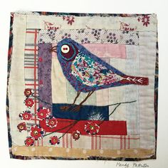 Bird. Embroidered and Applique unframed on to Vintage Log