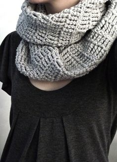Just a simple triple crochet? Infinity scarf. 9 inches wide by 2 ft long.